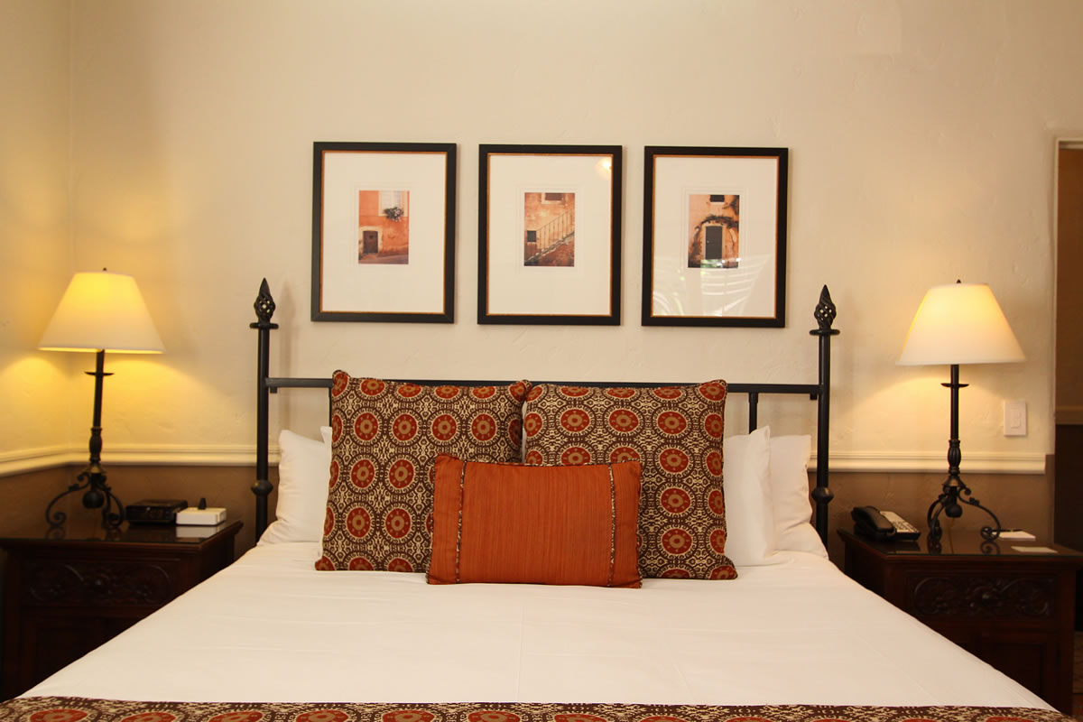 104 king fireplace bed Carmel Hotel Rooms Photo Gallery